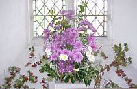 Some mauve and white dahlias decorate the church.