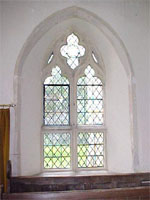 South window of the chancel near the organ.